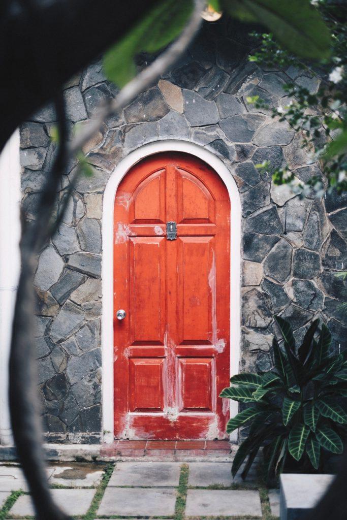 closed brown wooden panel door